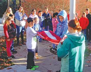 Fifth grade students at Highlands School got a lesson in the proper way to fly, lower and fold the American flag on Friday, Nov. 8.