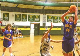 Highlands' Sam Stiwinter (44) goes up for a basket during the first half against Blue Ridge on Thursday, Nov. 21.