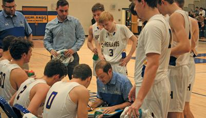 Highlands coach Brett Lamb draws up a play during a timeout against Murphy on Friday night.