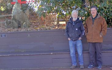 The Loafer's Bench outside of the former Stone Lantern property still serves as a popular resting place for visitors to Highlands, even after the business closed its doors earlier this year. Ralph deVille, Jim Bud Rogers (left) and Mike Thompson (right) built the bench more than 40 years ago.