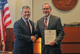 NC Attorney General Josh Stein gives mayor Patrick Taylor the 2019 Dogwood Award.