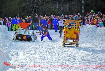 Lance Black, piloting the Poop Coop and his team of Luke Black, Chris Alexander and Jack Alexander, successfully slid to victory in the 14th annual Outhouse Races held Saturday, Feb. 15 at the Sapphire Valley Resort.