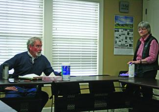 Mayor Patrick Taylor and commissioner Amy Patterson practice social distancing during their meeting on Monday.