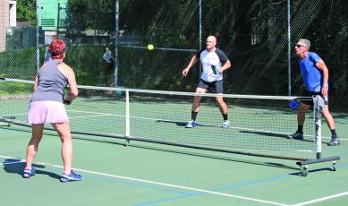 Pickleball players have been showing up early, and in high numbers, to get matches played before the summer sun raises the on-court temperature.