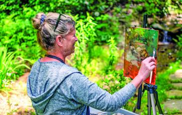 Madeline Dukes, a featured artist from Charleston, South Carolina, took advantage of perfect weather and beautiful scenery during the Cashiers Plein Air Festival held on July 15-19 at The Village Green.