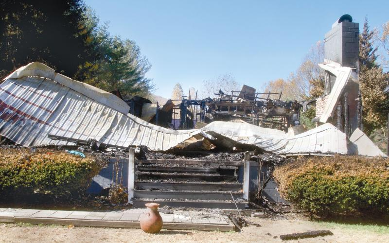 A southern Jackson County couple's Friendship Lane home of 26 years is a pile of charred debris Friday following a fire there the previous week. They also lost most of their possessions in the Oct. 26 blaze. (Photo by Don Richeson.)