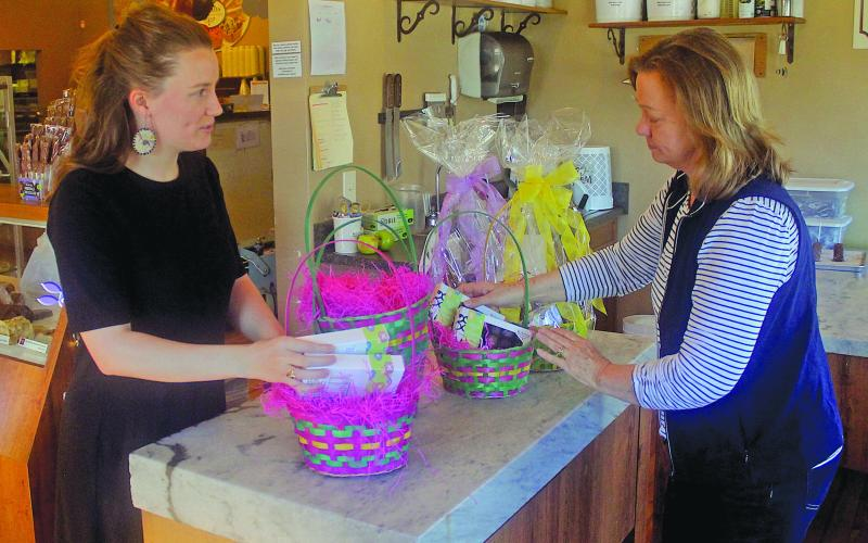 Kilwin's owner Ashley Clark and her mother Tallulah Adams pack baskets for their Easter basket sale this spring.