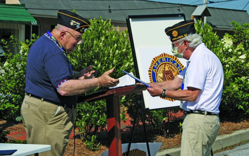 American Legion Post 370 commander Ed McCloskey presents Kenneth Knight with the 2020 Legionnaire of the Year award at Highlands Veteran's Plaza on Saturday.