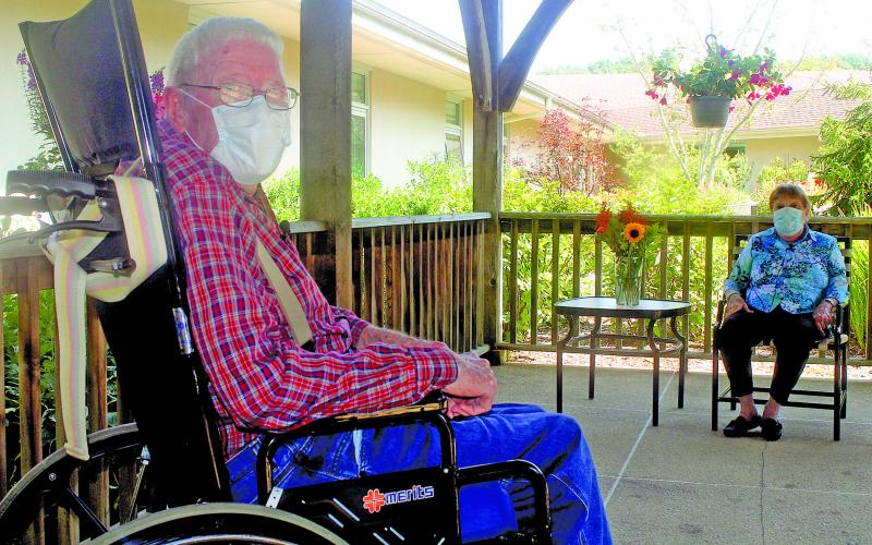 Eckerd Living Center resident Sherman Runion, 75, meets with Mary Jo, his wife of 52 years, during a visit in the living center's garden last week.