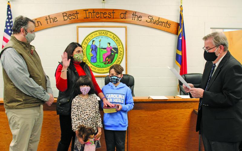 Hilary Wilkes takes her oath of office on Monday before joining the Macon County Board of Education as the board's Highlands representative.